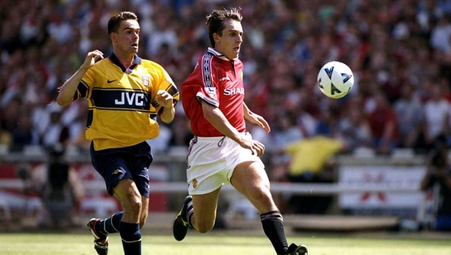 Gary Neville and Marc Overmars