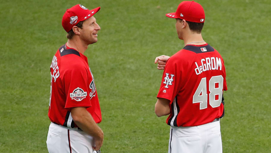 WASHINGTON, DC - JULY 16:  Max Scherzer #31 of the Washington Nationals and the National League and Jacob deGrom #48 of the New York Mets and the National League stand in the outfield during Gatorade All-Star Workout Day at Nationals Park on July 16, 2018 in Washington, DC.  (Photo by Patrick McDermott/Getty Images)