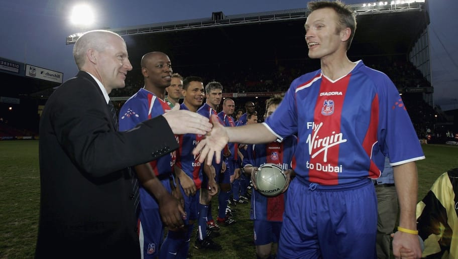LONDON - APRIL 06:  Geoff Thomas of Crystal Palace is welcomed onto the pitch by his old team mates and manager Steve Coppell during the Geoff Thomas Testimonial match between Crystal Palace and Manchester United at Selhurst Park on April 6, 2006 in London, England.  (Photo by Christopher Lee/Getty Images)