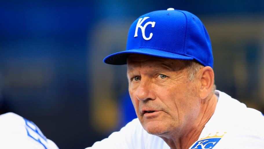 KANSAS CITY, MO - JUNE 05:  Hitting coach George Brett #5 of the Kansas City Royals watches from the dugout during the game against the Minnesota Twins at Kauffman Stadium on June 5, 2013 in Kansas City, Missouri.  (Photo by Jamie Squire/Getty Images)