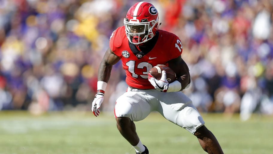 BATON ROUGE, LA - OCTOBER 13:  Elijah Holyfield #13 of the Georgia Bulldogs runs with the ball during a game against the LSU Tigers at Tiger Stadium on October 13, 2018 in Baton Rouge, Louisiana.  (Photo by Jonathan Bachman/Getty Images)