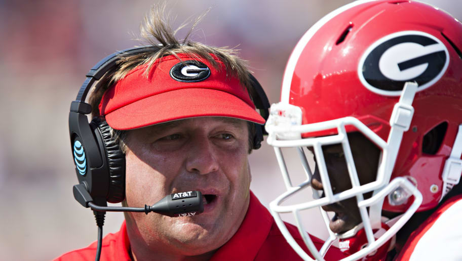 OXFORD, MS - SEPTEMBER 24:  Head Coach Kirby Smart of the Georgia Bulldogs talks with one of his players during a game against the Mississippi Rebels at Vaught-Hemingway Stadium on September 24, 2016 in Oxford, Mississippi.  The Rebels defeated the Bulldogs 45-14.  (Photo by Wesley Hitt/Getty Images)