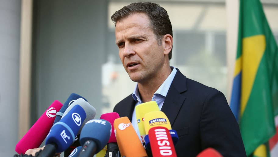 FRANKFURT AM MAIN, GERMANY - JUNE 28:  Team manager Oliver Bierhoff talks to the media during the return of the German national football team from the FIFA World Cup Russia 2018 at Frankfurt International Airport on June 28, 2018 in Frankfurt am Main, Germany.  (Photo by Alex Grimm/Bongarts/Getty Images)