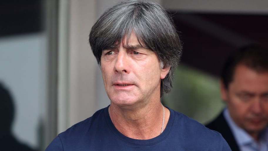 Germany's head coach Joachim Loew talks to media as he arrives at Frankfurt international airport on June 28, 2018, after flying back from Moscow following the German national football team's defeat in the Russia 2018 football World Cup. - Germany's embattled national team braced for a cold homecoming on June 28, 2018 after a shock World Cup exit that has plunged the football-mad nation into mourning and leaves the future of coach Joachim Loew in the balance. (Photo by Daniel ROLAND / AFP)        (Photo credit should read DANIEL ROLAND/AFP/Getty Images)