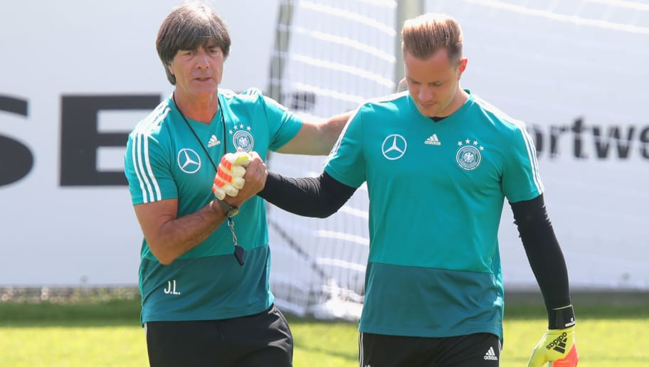 EPPAN, ITALY - JUNE 01:  Joachim Loew, head coach of the German national team shake hands with his keeper Marc-Andre ter-Stegen during a training session of the German national team at Sportanlage Rungg on day ten of  the Southern Tyrol Training Camp on June 1, 2018 in Eppan, Italy.  (Photo by Alexander Hassenstein/Bongarts/Getty Images)