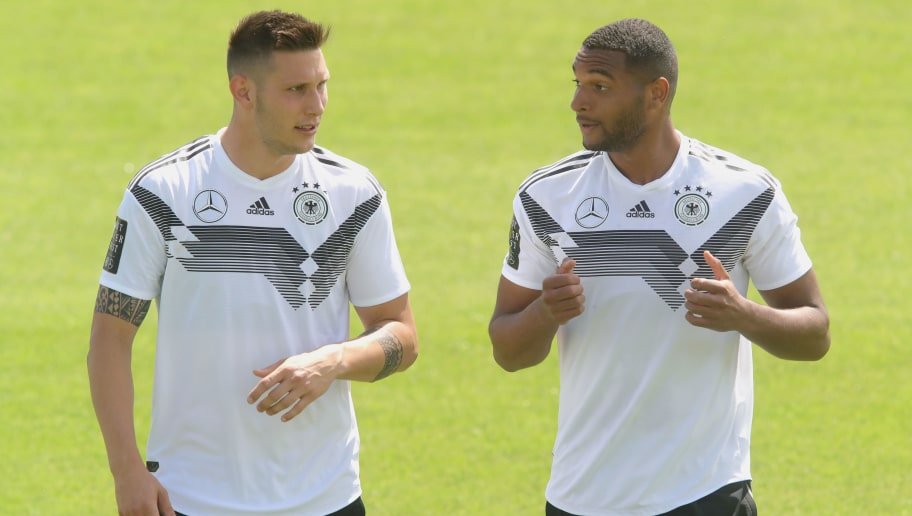 BOLZANO, ITALY - MAY 28:  Niklas Suele (L) talks to his team mate Jonathan Tah during a training session of the German national team at Sportanlage Rungg on day two of  the Southern Tyrol Training Camp on May 28, 2018 in Bolzano, Italy.  (Photo by Alexander Hassenstein/Bongarts/Getty Images)