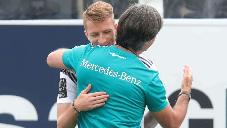 EPPAN, ITALY - MAY 31:  Joachim Loew, head coach of Germany congratulates  his player Marco Reus on his birthday during a training session of the German national team at Sportanlage Rungg on day nine of  the Southern Tyrol Training Camp on May 31, 2018 in Eppan, Italy.  (Photo by Alexander Hassenstein/Bongarts/Getty Images)