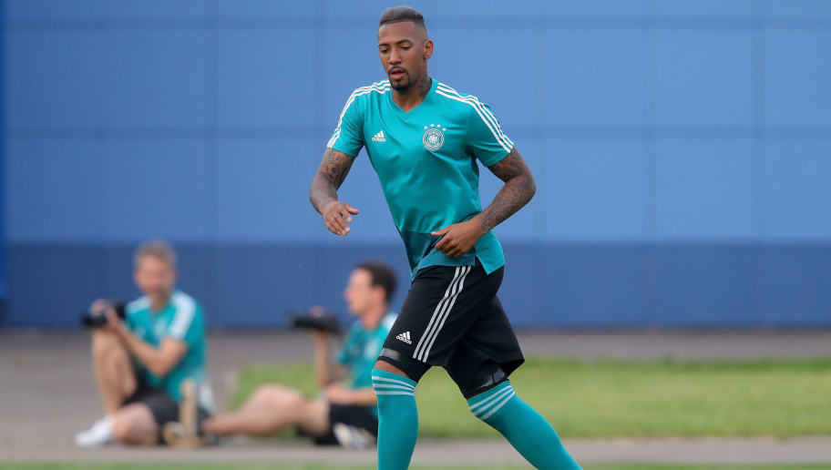 KAZAN, RUSSIA - JUNE 26:  Jerome Boateng of Germany runs with the ball during a Germany training session at Electron Stadium on June 26, 2018 in Kazan, Russia.  (Photo by Alexander Hassenstein/Getty Images)