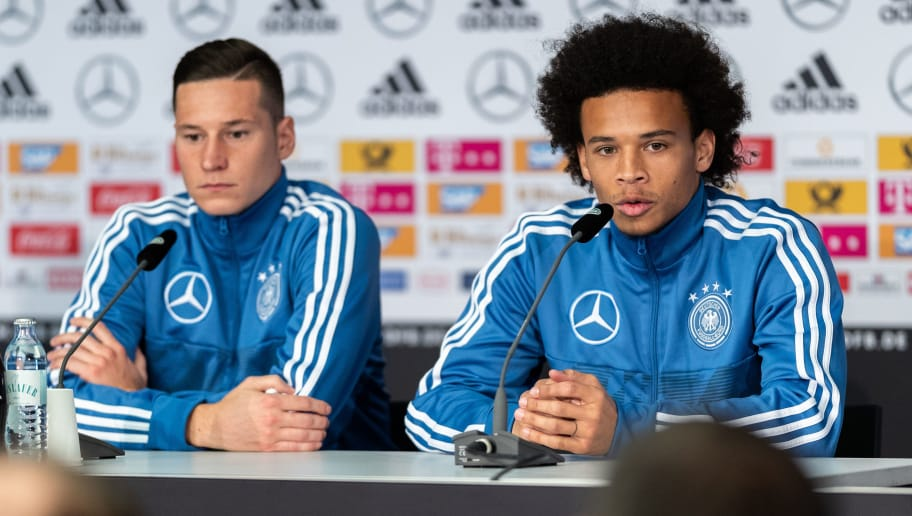 BERLIN, GERMANY - OCTOBER 10: Julian Draxler and Leroy Sane of Germany talks to the media during a press conference of the German national team at Mercedes-Benz am Salzufer on October 10, 2018 in Berlin, Germany. (Photo by Boris Streubel/Bongarts/Getty Images)