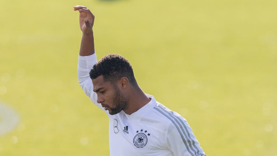 BERLIN, GERMANY - OCTOBER 10: Serge Gnabry of Germany streches during a training session of the German national team at Stadion auf dem Wurfplatz on October 10, 2018 in Berlin, Germany. (Photo by Boris Streubel/Bongarts/Getty Images)