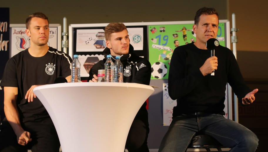 LEIPZIG, GERMANY - NOVEMBER 13:  Germany manager Oliver Bierhoff speaks as Timo Werner and Manuel Neuer look on during a Germany press conference at City of Leipzig High School on November 13, 2018 in Leipzig, Germany.  (Photo by Alexander Hassenstein/Bongarts/Getty Images)