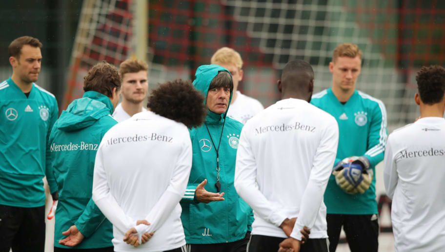 LEIPZIG, GERMANY - NOVEMBER 13:  Joachim Loew head coach of Germany (C) talks to players during a Germany training session at RB Leipzig Training Center on November 14, 2018 in Leipzig, Germany.  (Photo by Alexander Hassenstein/Bongarts/Getty Images)