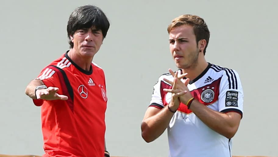 SANTO ANDRE, BRAZIL - JULY 05:  Joachim Loew (L), head coach of Germany tlks to Mario Goetze during the German national team training at Campo Bahia on July 5, 2014 in Santo Andre, Brazil.  (Photo by Martin Rose/Getty Images)