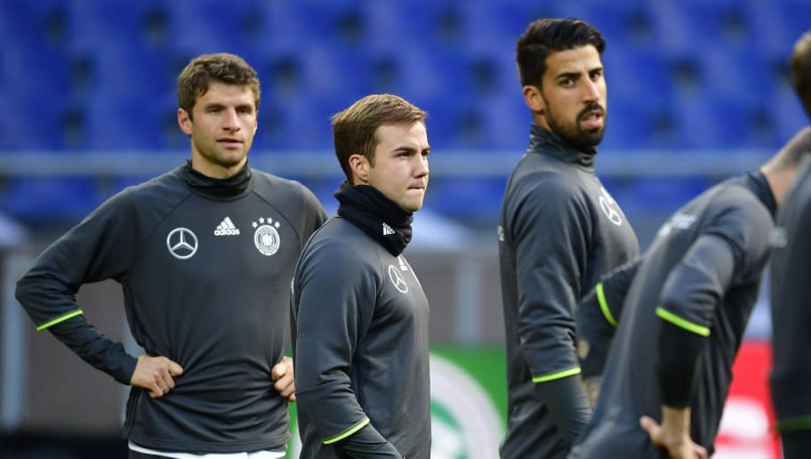 HANOVER, GERMANY - OCTOBER 10: Thomas Mueller, Mario Goetze, and Sami Khedira look on during a training session ahead of the 2018 FIFA World Cup Qualifier match between Germany and Ireland at HDI-Arena on October 10, 2016 in Hanover, Germany. The match will be held on October 11, 2016 in Hanover, Germany. The last match of the German national team in Hanover was canceled due to a bomb threat last year in November. (Photo by Alexander Koerner/Bongarts/Getty Images)