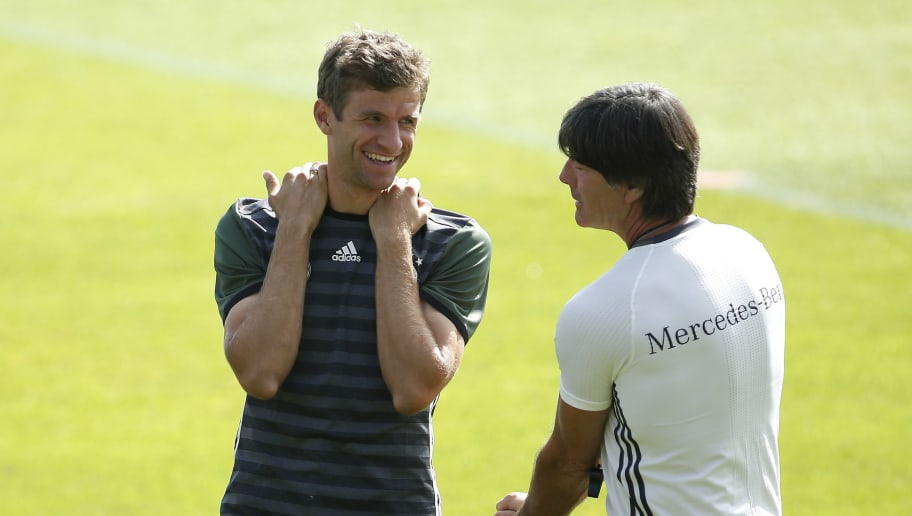 DUESSELDORF, GERMANY - SEPTEMBER 02:  Thomas Mueller (L) of Germany laughs with DFB head coach Joachim Loew during the training of the german national football team on September 2, 2016 in Duesseldorf, Germany. (Photo by Mika Volkmann/Bongarts/Getty Images)