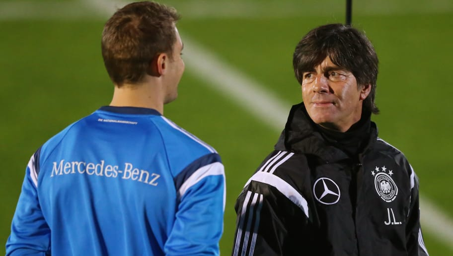 BERLIN, GERMANY - NOVEMBER 11:  Head coach Joachim Loew of Germany talks to goalkeeper Manuel Neuer during a training session ahead of the EURO 2016 Group D qualifying match against Gibraltar on November 11, 2014 in Berlin, Germany.  (Photo by Martin Rose/Bongarts/Getty Images)