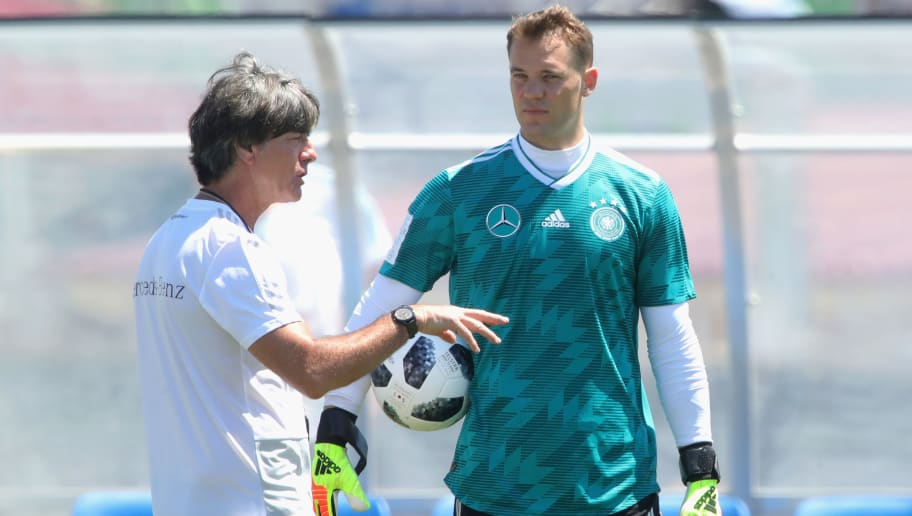 SOCHI, RUSSIA - JUNE 21:  Manuel Neuer of Germany speaks with head coach Joachim Loew during the Germany Training & Press Conference at Park Arena training ground on June 21, 2018 in Sochi, Russia.  (Photo by Alexander Hassenstein/Getty Images)
