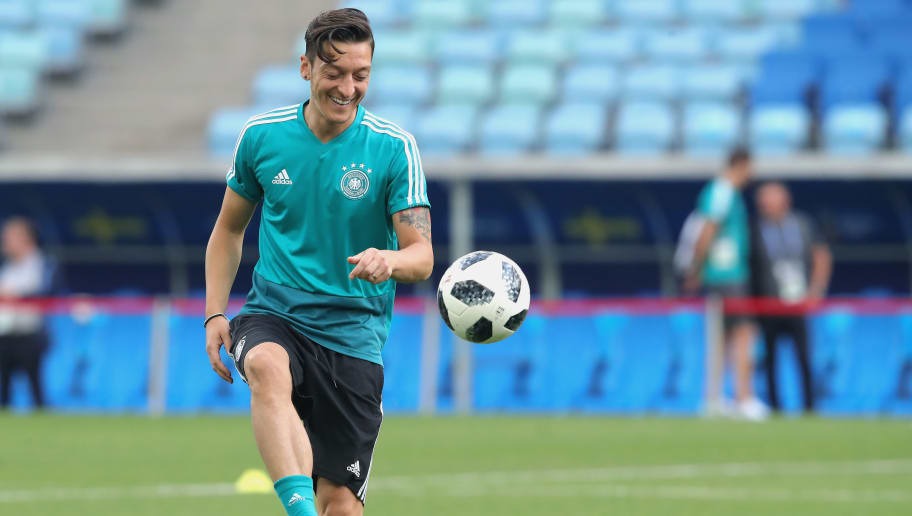SOCHI, RUSSIA - JUNE 22:  Mesut Oezil of Germany plays with the ball  during the Germany Training & Press Conference at Fisht Stadium on June 22, 2018 in Sochi, Russia.  (Photo by Alexander Hassenstein/Getty Images)