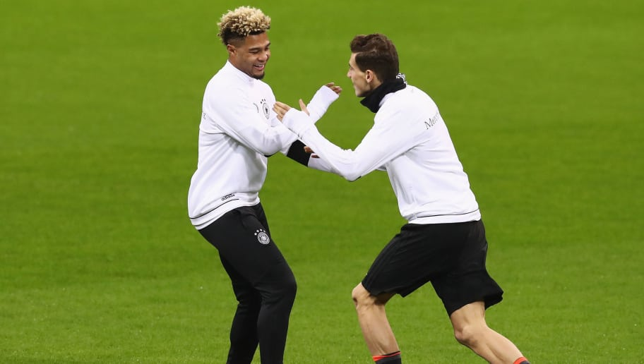 MILAN, ITALY - NOVEMBER 14:  Serge Gnabry (L) of Germany shares a joke with Leon Goretzka during a training session at San Siro Stadium on November 14, 2016 in Milan, Italy.  (Photo by Alexander Hassenstein/Bongarts/Getty Images)