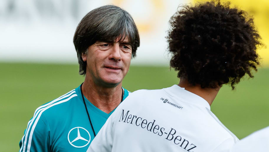 MUNICH, GERMANY - SEPTEMBER 04: Leroy Sane of Germany speak with Head coach Joachim Loew of Germany during a team Germany training session at Bayern Muenchen Campus on September 4, 2018 in Munich, Germany. (Photo by TF-Images/TF-Images via Getty Images)