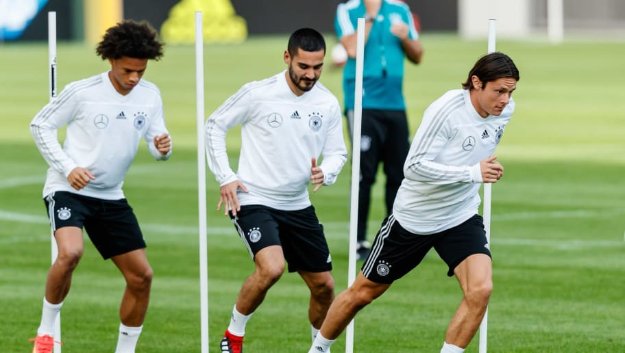 MUNICH, GERMANY - SEPTEMBER 04: Leroy Sane of Germany , lkay Guendogan of Germany , Nico Schulz of Germany controls the ball during a team Germany training session at Bayern Muenchen Campus on September 4, 2018 in Munich, Germany. (Photo by TF-Images/TF-Images via Getty Images)