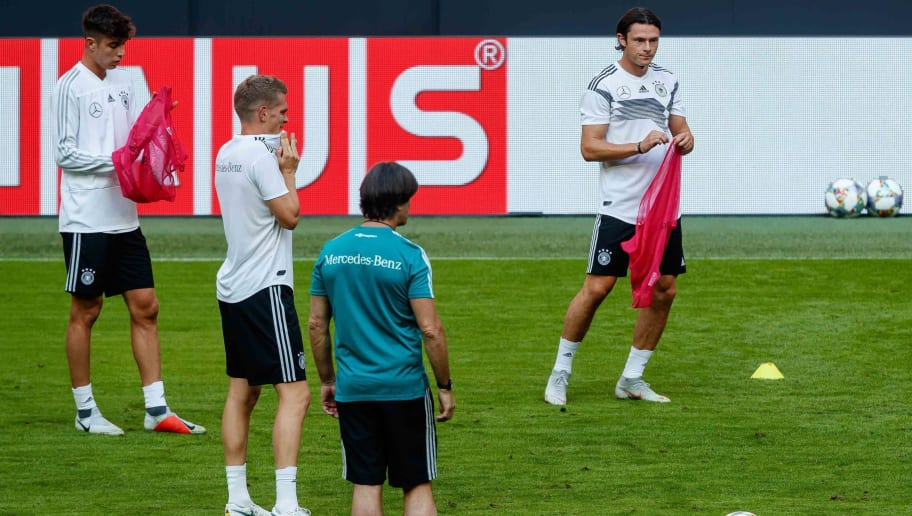 MUNICH, GERMANY - SEPTEMBER 05: Kai Havertz of Germany , Matthias Ginter of Germany , Head coach Joachim Loew of Germany , Nico Schulz of Germany looks on during a team Germany training session at Bayern Muenchen Campus on September 5, 2018 in Munich, Germany. (Photo by TF-Images/TF-Images via Getty Images)