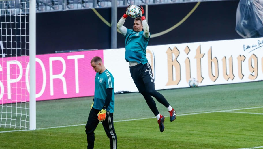 MUNICH, GERMANY - SEPTEMBER 05: Goalkeeper Manuel Neuer of Germany and Goalkeeper Marc-Andre ter Stegen of Germany controls the ball during a team Germany training session at Bayern Muenchen Campus on September 5, 2018 in Munich, Germany. (Photo by TF-Images/TF-Images via Getty Images)