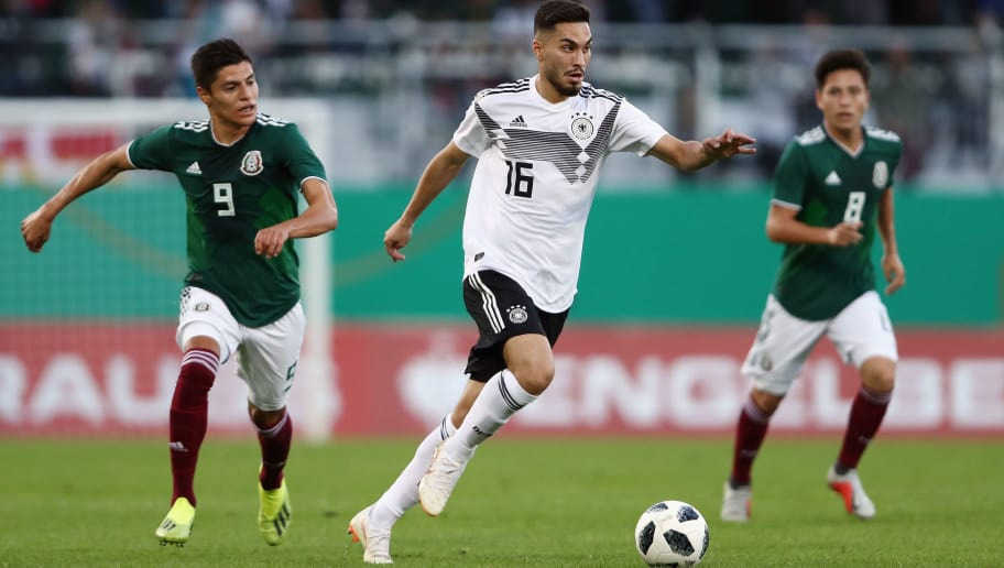 FUERTH, GERMANY - SEPTEMBER 07:  Suat Serdar of Germany is challenged by Ronaldo Cisneros of Mexico during the International Friendly match between Germany U21 and Mexico U21 at Sportpark Ronhof Thomas Sommer on September 7, 2018 in Fuerth, Germany.  (Photo by Alex Grimm/Bongarts/Getty Images)