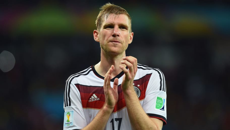 PORTO ALEGRE, BRAZIL - JUNE 30: Per Mertesacker of Germany acknowledges the fans after defeating Algeria 2-1 during the 2014 FIFA World Cup Brazil Round of 16 match between Germany and Algeria at Estadio Beira-Rio on June 30, 2014 in Porto Alegre, Brazil.  (Photo by Matthias Hangst/Getty Images)