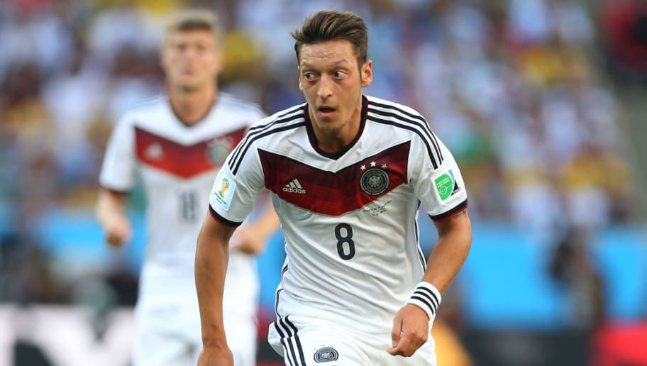 RIO DE JANEIRO, BRAZIL - JULY 13:  Mesut Ozil of Germany runs with the ball during the anthems during the 2014 World Cup final match between Germany and Argentina at The Maracana Stadium on July 13, 2014 in Rio de Janeiro, Brazil. (Photo by Ian MacNicol/Getty Images)