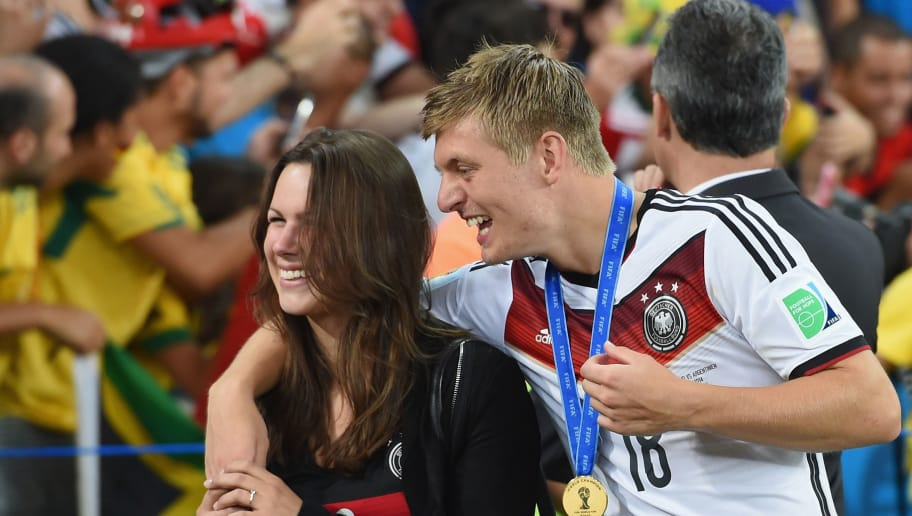 RIO DE JANEIRO, BRAZIL - JULY 13:  Toni Kroos of Germany celebrates with girlfriend Jessica Farber after defeating Argentina 1-0 in extra time during the 2014 FIFA World Cup Brazil Final match between Germany and Argentina at Maracana on July 13, 2014 in Rio de Janeiro, Brazil.  (Photo by Matthias Hangst/Getty Images)