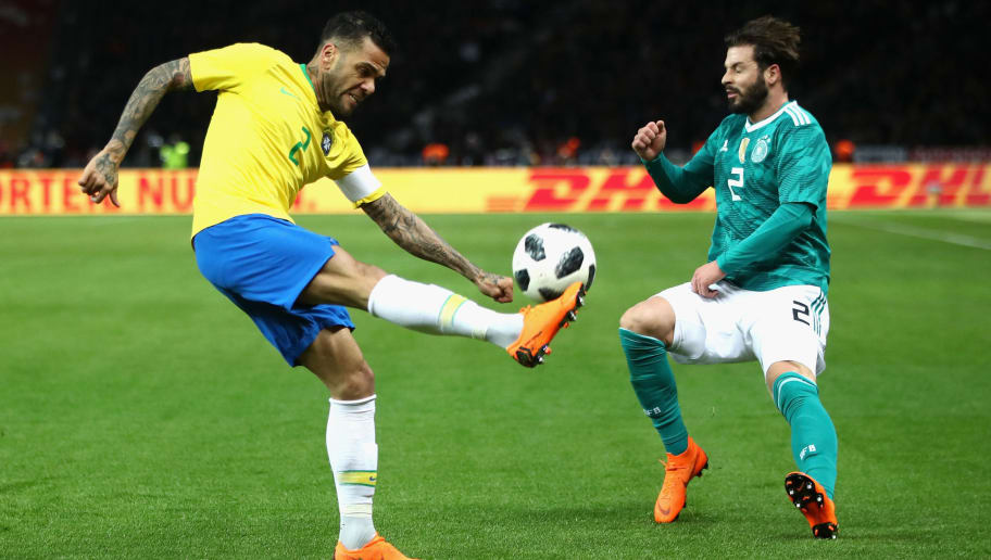 BERLIN, GERMANY - MARCH 27: Dani Alves of Brazil is challenged by Dani Alves of Brazil during the International friendly between Germany and Brazil at Olympiastadion on March 27, 2018 in Berlin, Germany.  (Photo by Alex Grimm/Bongarts/Getty Images)