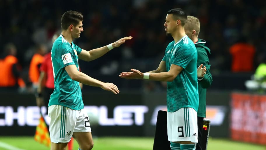 BERLIN, GERMANY - MARCH 27:  Mario Gomez of Germany greets Sandro Wagner of Germany as he is substituted off and Sandro Wagner comes on during the International friendly between Germany and Brazil at Olympiastadion on March 27, 2018 in Berlin, Germany.  (Photo by Martin Rose/Bongarts/Getty Images)