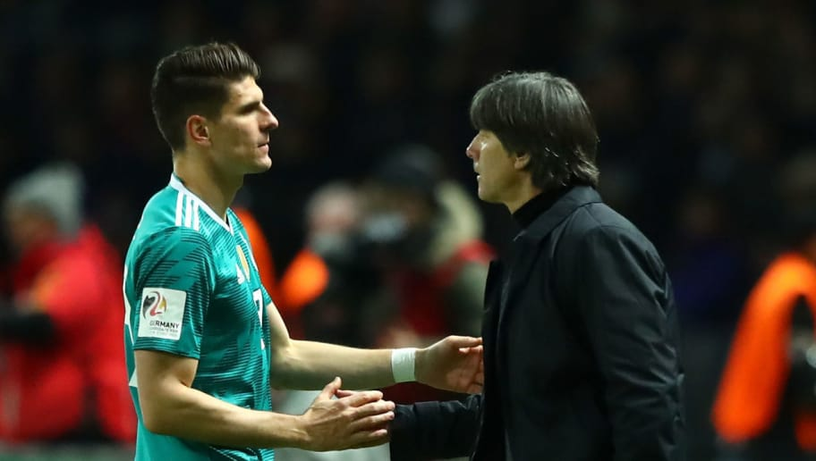 BERLIN, GERMANY - MARCH 27:  Mario Gomez of Germany greets Joachim Low, Manager of Germany as he is substituted off during the International friendly between Germany and Brazil at Olympiastadion on March 27, 2018 in Berlin, Germany.  (Photo by Martin Rose/Bongarts/Getty Images)