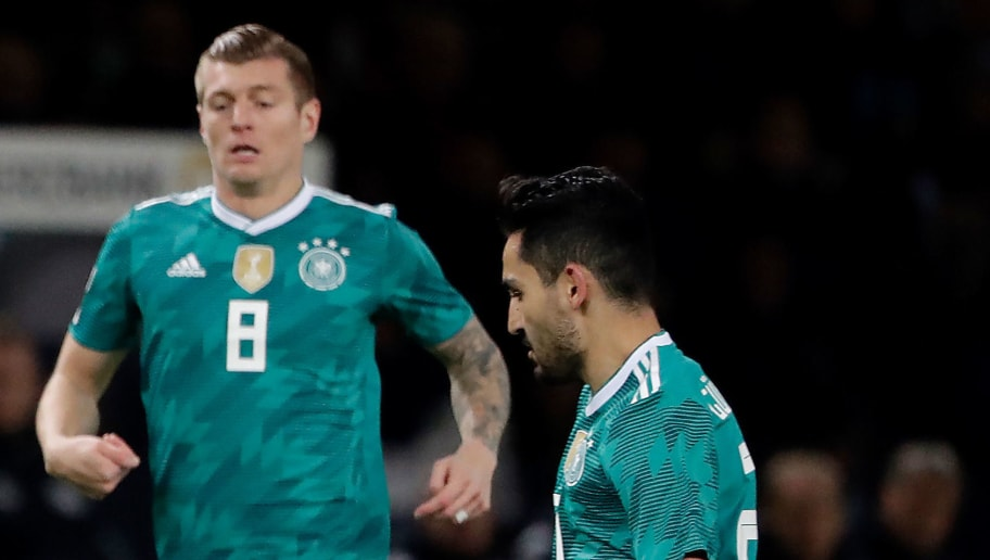 BERLIN, GERMANY - MARCH 27: (L-R) Dani Alves of Brazil, Toni Kroos of Germany, Ilkay Gundogan of Germany  during the  International Friendly match between Germany  v Brazil  at the Olympiastadium on March 27, 2018 in Berlin Germany (Photo by Cees van Hoogdalem/Soccrates/Getty Images)