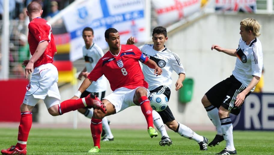 JENA, GERMANY - MAY 09: John Bostock of England (L) and Matthias Zimmermann of Germany battle for the ball during the UEFA U17 European Championship between Germany and England at the Ernst Abbe Sportfeld on May 9, 2009 in Jena, Germany.  (Photo by Enrico Radloff/Bongarts/Getty Images)