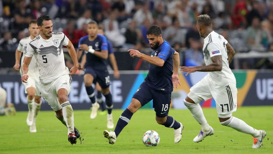 MUNICH, GERMANY - SEPTEMBER 06:  Nabil Fekir of France is challenged by Mats Hummels of Germany and Jerome Boateng of Germany during the UEFA Nations League Group A match between Germany and France at Allianz Arena on September 6, 2018 in Munich, Germany.  (Photo by Alexander Hassenstein/Bongarts/Getty Images)