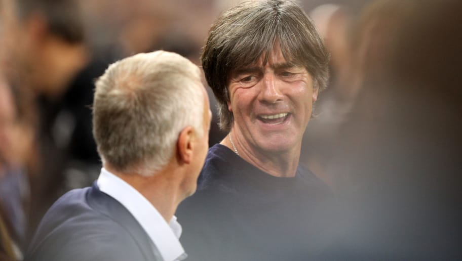 MUNICH, GERMANY - SEPTEMBER 06:  Joachim Low, Manager of Germany speaks to Didier Deschamps, Manager of France prior to the UEFA Nations League Group A match between Germany and France at Allianz Arena on September 6, 2018 in Munich, Germany.  (Photo by Adam Pretty/Bongarts/Getty Images)