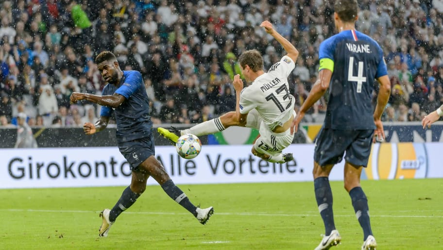 MUNICH, GERMANY - SEPTEMBER 06: Samuel Umtiti of France, Thomas Mueller of Germany and Raphael Varane of France battle for the ball during the UEFA Nations League group A match between Germany and France at Allianz Arena on September 6, 2018 in Munich, Germany. (Photo by TF-Images/Getty Images)