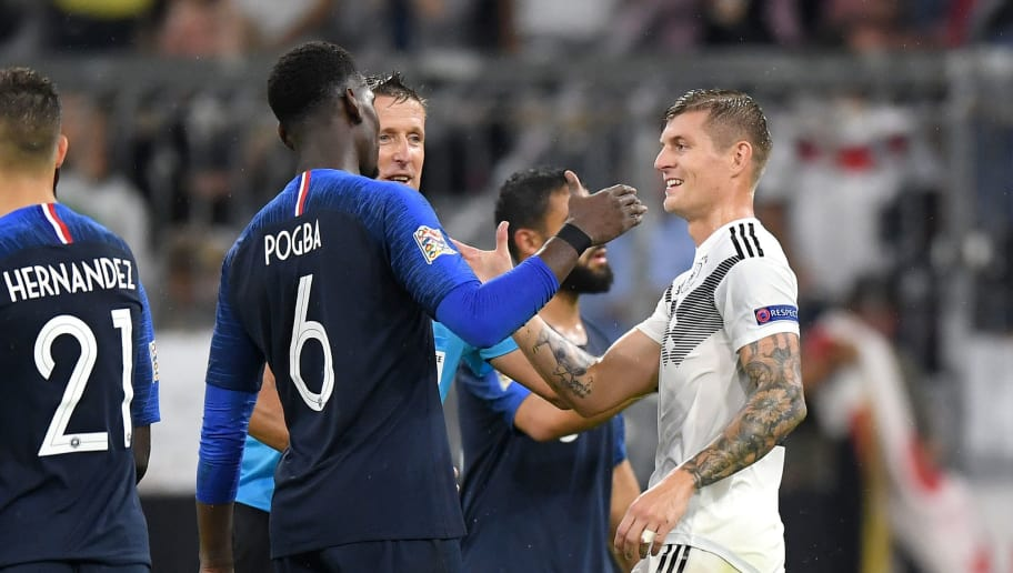 MUNICH, GERMANY - SEPTEMBER 06: Paul Pogba of France and Toni Kroos of Germany shake hands after the UEFA Nations League Group A match between Germany and France at Allianz Arena on September 6, 2018 in Munich, Germany.  (Photo by Matthias Hangst/Bongarts/Getty Images)