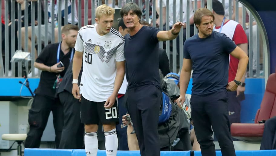MOSCOW, RUSSIA - JUNE 17:  Joachim Loew, head coach of Germany talks to his player Julian Brandt  during the 2018 FIFA World Cup Russia group F match between Germany and Mexico at Luzhniki Stadium on June 17, 2018 in Moscow, Russia.  (Photo by Alexander Hassenstein/Getty Images)