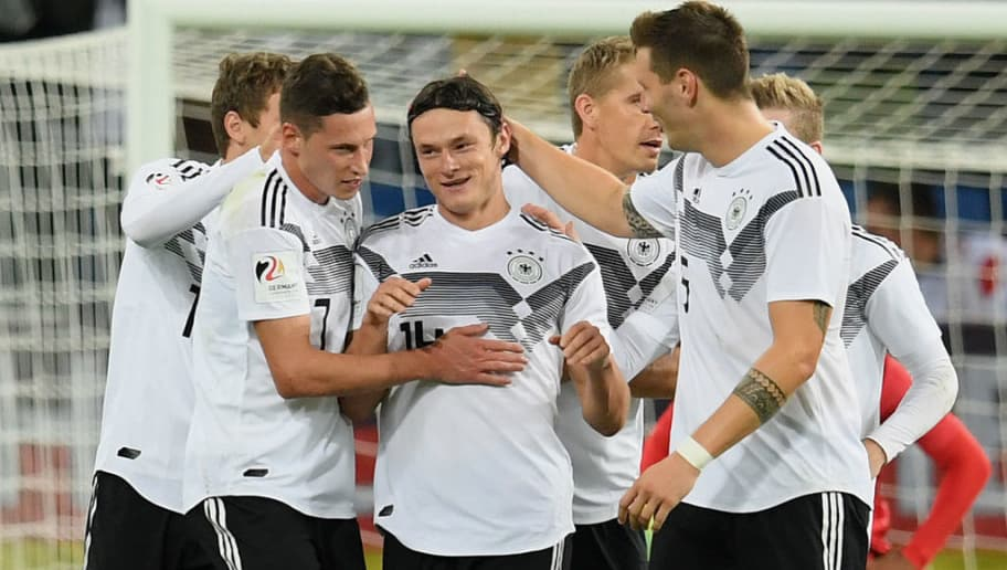 SINSHEIM, GERMANY - SEPTEMBER 09: Nico Schulz of Germany celebrates with his team-mates after scoring his team's second goal  during the International Friendly match between Germany and Peru on September 9, 2018 in Sinsheim, Germany. (Photo by Matthias Hangst/Bongarts/Getty Images)
