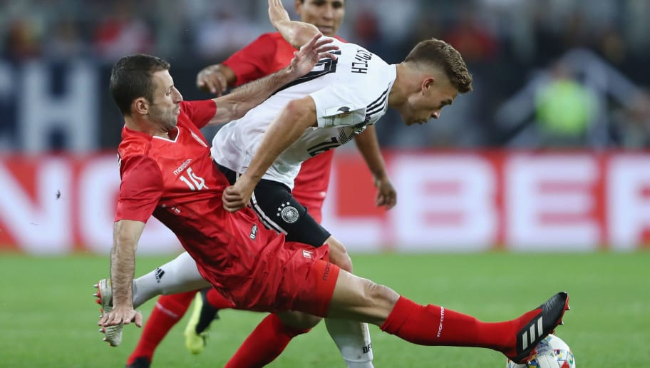 SINSHEIM, GERMANY - SEPTEMBER 09: Joshua Kimmich of Germany is challenged by Horacio Calcaterra of Peru during the International Friendly match between Germany and Peru at Wirsol Rhein-Neckar-Arena on September 9, 2018 in Sinsheim, Germany.  (Photo by Alex Grimm/Bongarts/Getty Images)