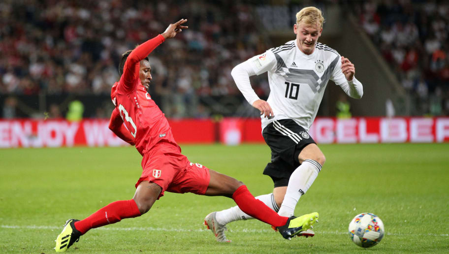 SINSHEIM, GERMANY - SEPTEMBER 09:  Julian Brandt of Germany is challanged by Pedro Aquino of Peru during the International Friendly match between Germany and Peru at Rhein-Neckar-Arena on September 9, 2018 in Sinsheim, Germany.  (Photo by Adam Pretty/Bongarts/Getty Images)