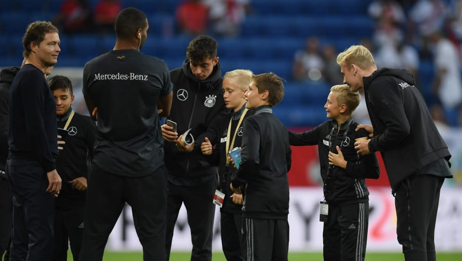 SINSHEIM, GERMANY - SEPTEMBER 09: Kai Havertz of Germany and Julian Brandt of Germany take photos with escort kids prior to the International Friendly match between Germany and Peru on September 9, 2018 in Sinsheim, Germany. (Photo by Matthias Hangst/Bongarts/Getty Images)