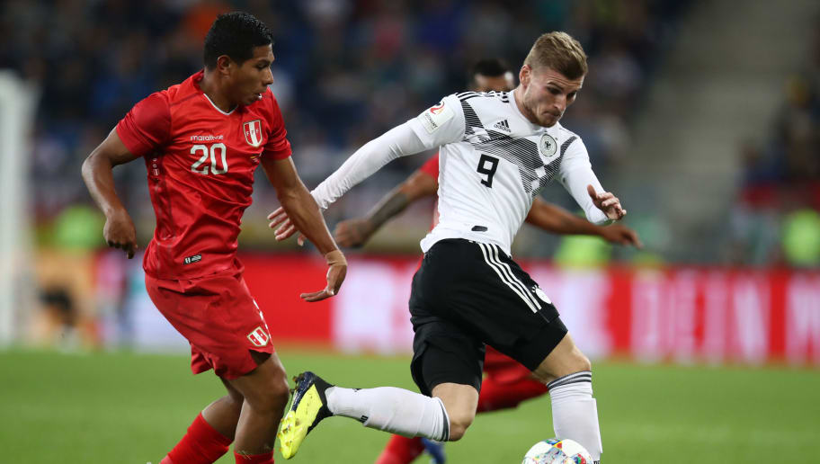 SINSHEIM, GERMANY - SEPTEMBER 09:  Timo Werner of Germany and Edison Flores of Peru in action during the International Friendly match between Germany and Peru at Rhein-Neckar-Arena on September 9, 2018 in Sinsheim, Germany.  (Photo by Maja Hitij/Bongarts/Getty Images)