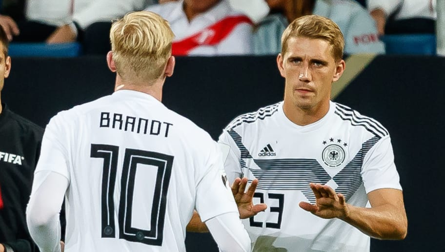 SINSHEIM, GERMANY - SEPTEMBER 09: Nils Petersen of Germany shakes hands with Julian Brandt of Germany during the International Friendly match between Germany and Peru on September 9, 2018 in Sinsheim, Germany. (Photo by TF-Images/Getty Images)