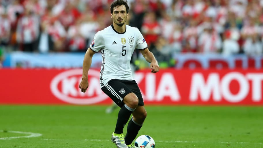 PARIS, FRANCE - JUNE 16:  Mats Hummels of Germany runs with the ball during the UEFA EURO 2016 Group C match between Germany and Poland at Stade de France on June 16, 2016 in Paris, France.  (Photo by Alexander Hassenstein/Getty Images)