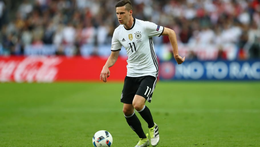 PARIS, FRANCE - JUNE 16:  Julian Draxler  of Germany runs with the ball during the UEFA EURO 2016 Group C match between Germany and Poland at Stade de France on June 16, 2016 in Paris, France.  (Photo by Alexander Hassenstein/Getty Images)