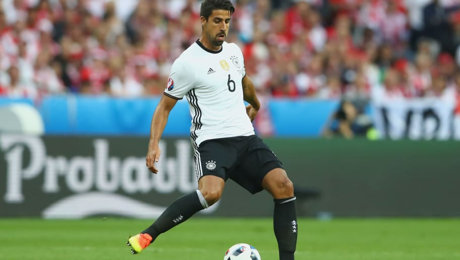 PARIS, FRANCE - JUNE 16:  Sami Khedira of Germany runs with the ball during the UEFA EURO 2016 Group C match between Germany and Poland at Stade de France on June 16, 2016 in Paris, France.  (Photo by Alexander Hassenstein/Getty Images)